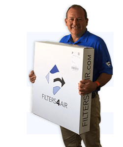 David Dilling holding a box of filters